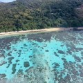Helicopter tour flying over coral coast in Vanuatu