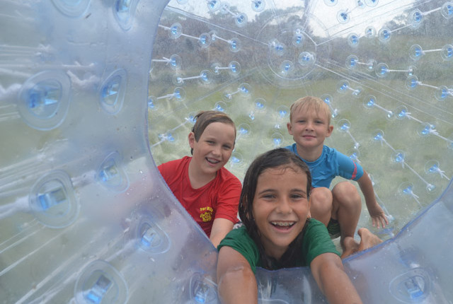 Kids having fun zorbing in Vanuatu at the water park